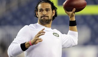 FILE - In a Sept. 12, 2013 filel photo, New York Jets quarterback Mark Sanchez, who normally throws right-handed, throws a pass with his left hang before an NFL football between the New England Patriots and the Jets game, in Foxborough. The New York Jets released Sanchez signed quarterback Michael Vick on Friday, March 21, 2014. Sanchez spent this past season on injured reserve after injuring his right shoulder in a preseason game. (AP Photo/Charles Krupa, File)