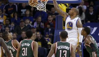 Golden State Warriors' Marreese Speights (5) scores as Milwaukee Bucks, from left, Giannis Antetokounmpo, John Henson (31), Ramon Sessions, and Khris Middleton watch during the first half of an NBA basketball game Thursday, March 20, 2014, in Oakland, Calif. (AP Photo/Ben Margot)