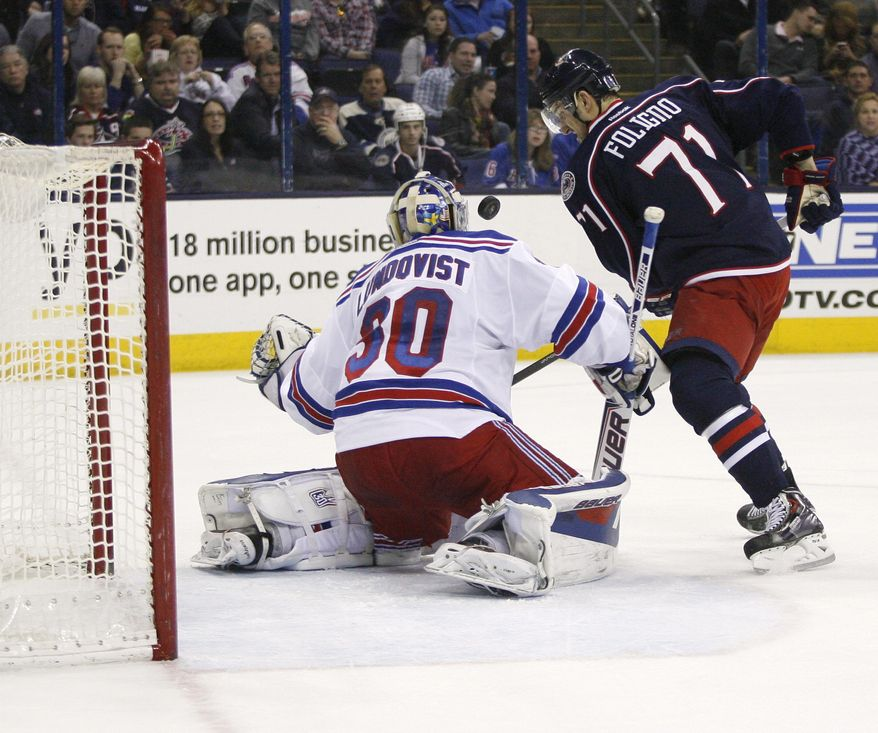 Columbus Blue Jackets' Nick Foligno (71) shoots against New York Rangers goalie Henrik Lundqvist (30), of Sweden, during the second period of an NHL hockey game, Friday, March 21, 2014, in Columbus, Ohio. (AP Photo/Mike Munden)
