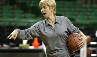 Baylor head coach Kim Mulkey instructs her team during practice at the NCAA women's college basketball tournament, Friday, March 21, 2014, in Waco, Texas. Mulkey will not coach the first-round game scheduled to be played Saturday against Western Kentucky. Mulkey was suspended for the game after criticizing officiating in the 2013 NCAA playoffs. (AP Photo/Tony Gutierrez)