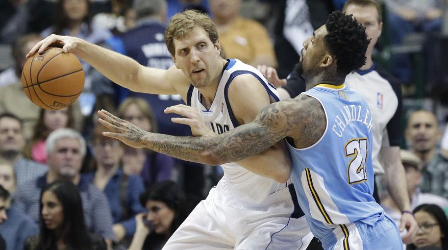 Dallas Mavericks forward Dirk Nowitzki (41) of Germany keeps the ball from Denver Nuggets forward Wilson Chandler (21) during the first half an NBA basketball game Friday, March 21, 2014, in Dallas. (AP Photo/LM Otero)
