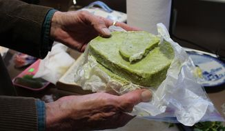 ** FILE ** Chuck Ream of Ann Arbor, Mich., holds marijuana butter for baking on March 19, 2014, in Ann Arbor. Edible forms of medical marijuana would be legalized by legislation currently under consideration in the Michigan Senate. (AP Photo/Emma Fidel)