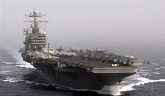 ** FILE ** The aircraft carrier USS Abraham Lincoln transits the Arabian Sea Dec. 5, 2010, while conducting flight operations. (U.S. Department of Defense)