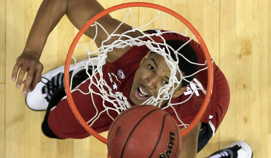 Stanford's Anthony Brown watches his shot during the second half of a second-round game against New Mexico in the NCAA college basketball tournament Friday, March 21, 2014, in St. Louis. Stanford won 58-53. AP Photo/Jeff Roberson)