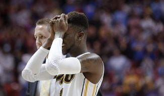 Virginia Commonwealth guard JeQuan Lewis reacts after VCU lost 77-75 to Stephen F. Austin in overtime during a second-round game in the NCAA men's college basketball tournament Friday, March 21, 2014, in San Diego. (AP Photo/Lenny Ignelzi)