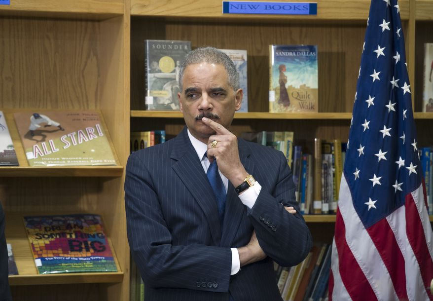 "Attorney General Eric Holder participates in a discussion on the importance of universal access to preschool and the need to reduce ""unnecessary and unfair school discipline practices and other barriers to equity and opportunity at all levels of education"" Friday, March 21, 2014, at J. Ormond Wilson Elementary School library in Washington. (AP Photo/Cliff Owen)"