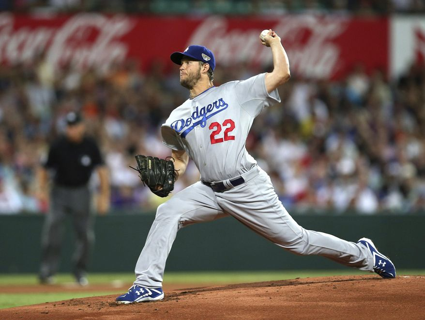 The Dodgers' Clayton Kershaw throws his first pitch of the Major League Baseball 2014 season during the opening game between the Los Angeles Dodgers and Arizona Diamondbacks at the Sydney Cricket ground in Sydney, Saturday, March 22, 2014.  (AP Photo/Rick Rycroft)