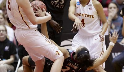 Florida State's Ivey Slaughter (23) falls down after a foul by Iowa State's Hallie Christofferson (5), with Iowa State's Nikki Moody (4) and Florida State's Natasha Howard (33) looking on, in the second half of a first-round game in the NCAA women's college basketball tournament in Ames, Iowa, Saturday, March 22, 2014. (AP Photo/Nati Harnik)
