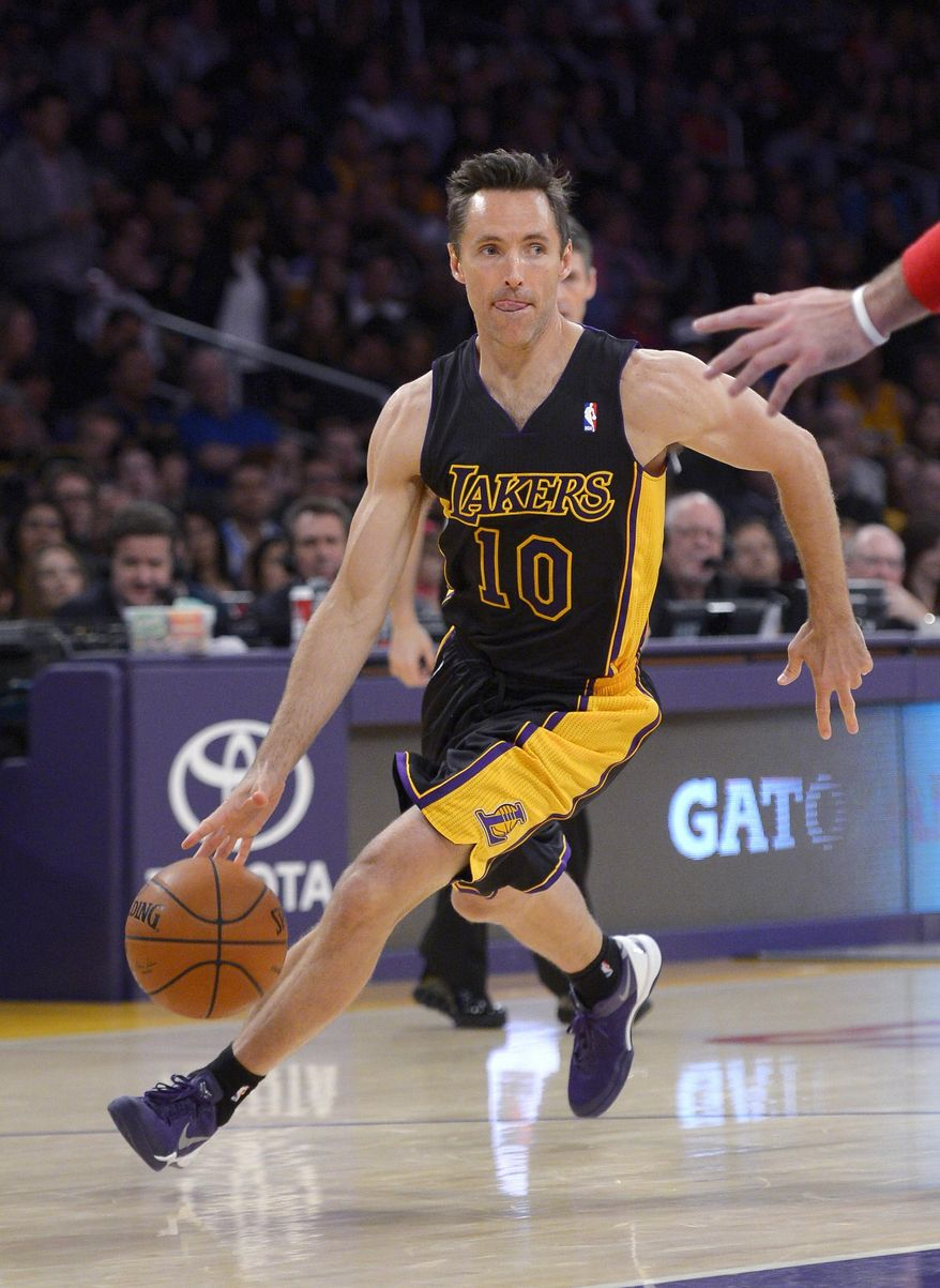 Los Angeles Lakers guard Steve Nash dribbles the ball during the first half of an NBA basketball game against the Washington Wizards, Friday, March 21, 2014, in Los Angeles. (AP Photo/Mark J. Terrill)
