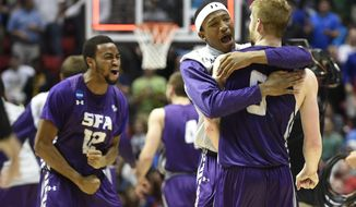 Stephen F. Austin forward Ben Brown-White, second from right, hugs teammate guard Thomas Walkup, right, after defeating Virginia Commonwealth 77-75 in overtime in a second-round game in the NCAA college basketball tournament Friday, March 21, 2014, in San Diego. (AP Photo/Denis Poroy)