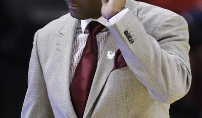 North Carolina Central head coach LeVelle Moton walks the sideline against Iowa State during the first half of a second-round game in the NCAA college basketball tournament Friday, March 21, 2014, in San Antonio. (AP Photo/Eric Gay)