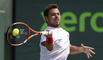 Stanislas Wawrinka, of Switzerland, returns to  Daniel Gimeno-Traver, of Spain, at the Sony Open tennis tournament in Key Biscayne, Fla., Saturday, March 22, 2014. (AP Photo/Alan Diaz)