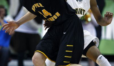Upper Arlington's Logan Richter, left, tries to get around Lakewood St. Edward's Mike Ryan during the first quarter of the OHSAA Division I boys' high school basketball championship game in Columbus, Ohio, Saturday, March 22, 2014. (AP Photo/Paul Vernon)