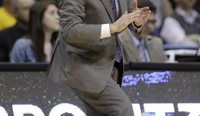 Kansas State head coach Bruce Weber yells on the sideline during the first half of a second-round game against Kentucky in the NCAA college basketball tournament Friday, March 21, 2014, in St. Louis. (AP Photo/Jeff Roberson)