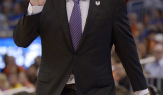 Pittsburgh head coach Jamie Dixon gestures during the first half in a third-round game in the NCAA college basketball tournament against Florida, Saturday, March 22, 2014, in Orlando, Fla. (AP Photo/Phelan M. Ebenhack)