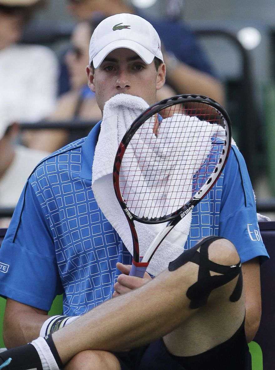 John Isner, of the United States, rests between sets during a match against Donald Young, of the United States, at the Sony Open tennis tournament, Saturday, March 22, 2014, in Key Biscayne, Fla. (AP Photo/Wilfredo Lee)