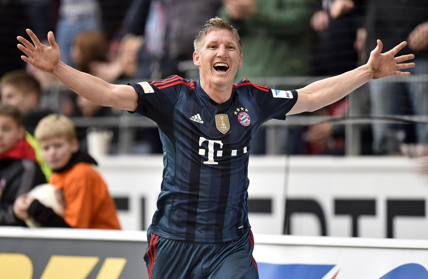 Bayern's Bastian Schweinsteiger celebrates after scoring  during  the German Bundesliga soccer match between FSV Mainz 05 and Bayern Munich in Mainz,  Germany, Saturday, March 22, 2014. (AP Photo/Martin Meissner)