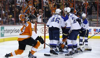 Philadelphia Flyers' Scott Hartnell, left, reacts after scoring a goal during the second period of an NHL hockey game against the St. Louis Blues, Saturday, March 22, 2014, in Philadelphia. (AP Photo/Matt Slocum)