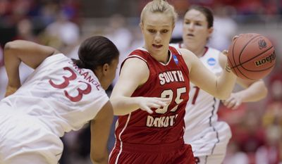 South Dakota's Nicole Seekamp (35) tries to drive past Stanford's Amber Orrange (33) in the first half of a first-round game in the NCAA women's college basketball tournament in Ames, Iowa, Saturday, March 22, 2014. (AP Photo/Nati Harnik)