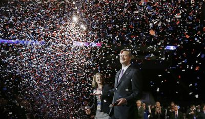 Charlie Baker the frontrunner and favorite in the Republican nomination process for governor stands with his wife Lauren as they are bathed in confetti after he addresses attendees, accepting their nomination, at the Massachusetts Republican state convention in Boston, Saturday, March 22, 2014. (AP Photo/Stephan Savoia)