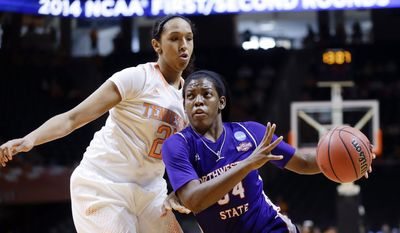Northwestern State forward Kourtney Pennywell, right, drives against Tennessee center Mercedes Russell, left, during the first half of a first-round game in the NCAA women's college basketball tournament Saturday, March 22, 2014, in Knoxville, Tenn. (AP Photo/Mark Humphrey)