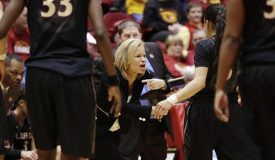 Florida State coach Sue Semrau, left, calls instructions in the first half of a first-round game against Iowa State in the NCAA women's college basketball tournament in Ames, Iowa, Saturday, March 22, 2014. (AP Photo/Nati Harnik)