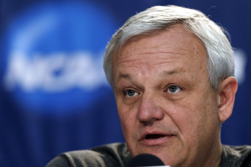 Mercer head coach Bob Hoffman answers a question during a news conference at the NCAA college basketball tournament in Raleigh, N.C., Saturday, March 22, 2014. Mercer plays Tennessee in a third-round game on Sunday. (AP Photo/Chuck Burton