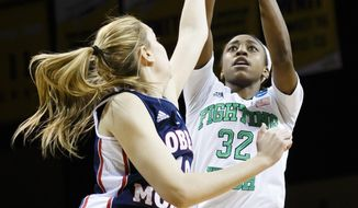 Notre Dame guard Jewell Loyd (32) shoots over Robert Morris guard Rebeca Navarro (10) during the first half in a first-round game in the NCAA women's college basketball tournament, Saturday, March 22, 2014, in Toledo, Ohio. (AP Photo/Rick Osentoski)