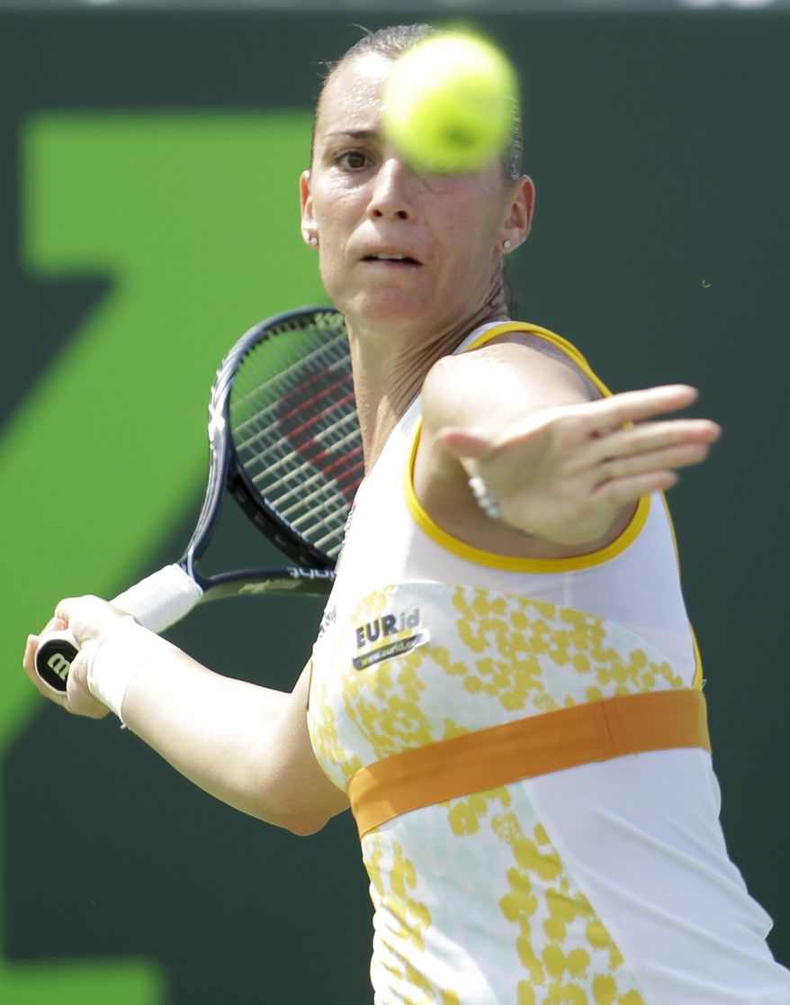 Flavia Pennetta, of Italy, returns the ball to Ana Ivanovic, of Serbia, during the Sony Open tennis tournament, Saturday, March 22, 2014, in Key Biscayne, Fla. (AP Photo/Luis M. Alvarez)