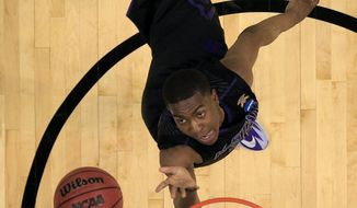 Kansas State's Wesley Iwundu heads to the basket during the second half of a second-round game against Kentucky in the NCAA college basketball tournament Friday, March 21, 2014, in St. Louis. Kentucky won 56-49. (AP Photo/Jeff Roberson)