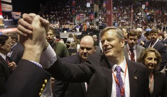 Charlie Baker the frontrunner and favorite in the Republican nomination process for governor greets attendees at the Massachusetts Republican State Convention in Boston, Saturday, March 22, 2014. (AP Photo/Stephan Savoia)
