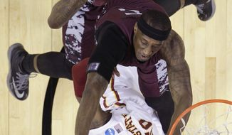 Iowa State's DeAndre Kane (50) is fouled by  North Carolina Central's Ebuka Anyaorah (5) as he tries to score during the second half of a second-round game in the NCAA college basketball tournament Friday, March 21, 2014, in San Antonio. Iowa State won 93-75. (AP Photo/Eric Gay)