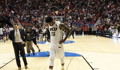 Virginia Commonwealth forward Juvonte Reddic walks off the court after losing to Stephen F. Austin 77-75 in overtime in a second-round game in the NCAA college basketball tournament Friday, March 21, 2014, in San Diego.  (AP Photo/Lenny Ignelzi )