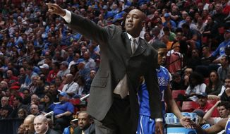 Tulsa coach Danny Manning gestures as his team plays UCLA during the first half of a second-round game in the NCAA men's college basketball tournament Friday, March 21, 2014, in San Diego. (AP Photo/Lenny Ignelzi)