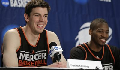Mercer's Daniel Coursey, left, and Langston Hall, right, laugh as Coursey answers a question during a news conference at an NCAA college basketball tournament in Raleigh, N.C., Saturday, March 22, 2014. Mercer plays Tennessee in a third-round game on Sunday. (AP Photo/Chuck Burton)