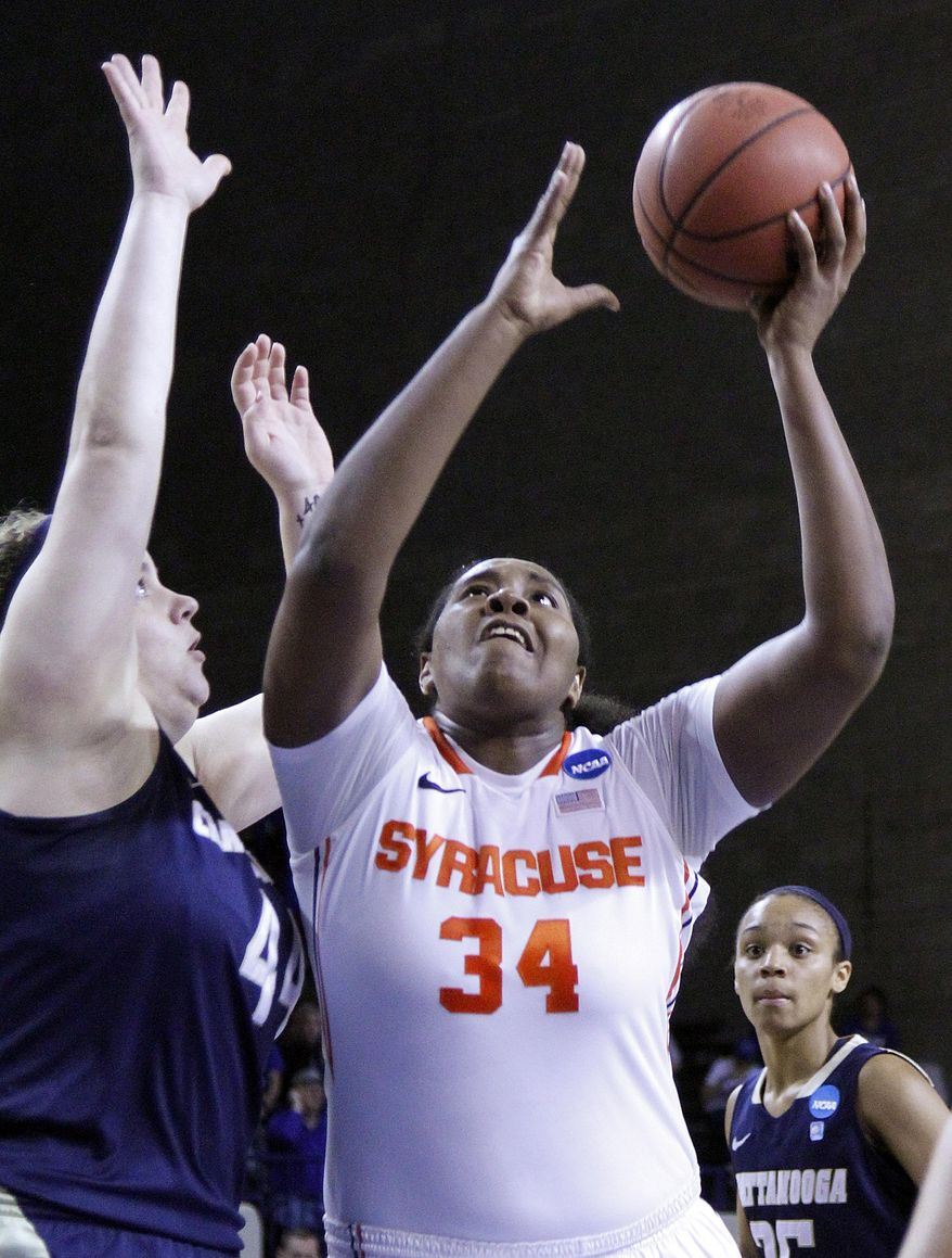 Syracuse's Shakeya Leary (34) shoots as Chattanooga's Ashlen Dewart defends during the first half of a first-round NCAA college basketball game in Lexington, Ky., Saturday, March 22, 2014. (AP Photo/James Crisp)