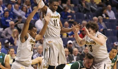 Cal Poly forward Zach Gordon is surrounded by Wichita State defenders Darius Carter (left), Cleanthony Early (11) and Evan Wessel, RIGHT,  during the first half of a second-round game in the NCAA college basketball tournament Friday, March 21, 2014, in St. Louis. (AP Photo/St. Louis Post-Dispatch, Chris Lee)  EDWARDSVILLE INTELLIGENCER OUT; THE ALTON TELEGRAPH OUT