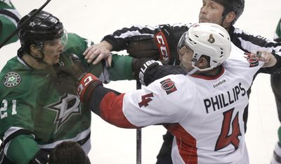 CORRECTS TO REFEREE CHRIS ROONEY NOT LINESMAN JAY SHARRERS Ottawa Senators defenseman Chris Phillips (4) tangles with Dallas Stars left wing Antoine Roussel (21) as referee Chris Rooney tries to break it up during the second period an NHL Hockey game, Saturday, March 22, 2014, in Dallas. (AP Photo/LM Otero)