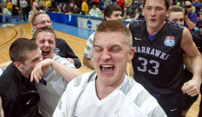 Wisconsin-Whitewater player Clay Stephens, center, celebrates with teammates Steven Egan, right, and Sean Klemp after winning an NCAA Division III college basketball championship game at the Salem Civic Center, Saturday, March 22, 2014, in Salem, Va.  Wisconsin-Whitewater defeated Williams 75-73.(AP Photo/Don Petersen)