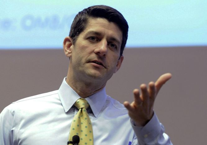 **FILE** Rep. Paul Ryan, Wisconsin Republican, answers constituents' questions during a listening session at the Snap-on Headquarters in Kenosha, Wis., on March 20, 2014. (Associated Press/Keno