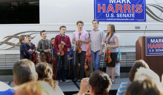 FILE - In this March 14, 2014 file photo, children from the Duggar family sing during a campaign event for Rev. Mark Harris, who is seeking a Republican U.S. Senate nomination in the upcoming North Carolina primary, in Raleigh, N.C., The Duggars, with 19 children in all, star in a reality TV show.  (AP Photo/Ted Richardson)