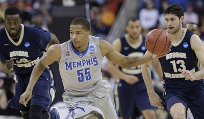 Memphis guard Geron Johnson (55) moves the ball against George Washington forward Isaiah Armwood, left, and Patricio Garino (13) during the second half of an NCAA college basketball second-round tournament game, Friday, March 21, 2014, in Raleigh. (AP Photo/Gerry Broome)