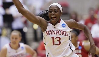 Stanford's Chiney Ogwumike (13) celebrates after scoring in the first half of a first-round game in the NCAA women's college basketball tournament against South Dakota in Ames, Iowa, Saturday, March 22, 2014. (AP Photo/Nati Harnik)