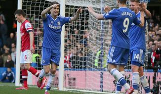 Chelsea's Oscar, 2nd left, celebrates after scoring his side's 4th goal of the game during their English Premier League soccer match between Chelsea and Arsenal at Stamford Bridge stadium in London, Saturday, March,  22,  2014. (AP Photo/Alastair Grant)