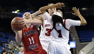 Fresno State's Alex Furr (11) drives to the basket past Nebraska's Tear'a Laudermill (1) during the first half of a first-round game in the NCAA women's college basketball tournament on Saturday, March 22, 2014, in Los Angeles. (AP Photo/Jae C. Hong)