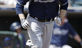 San Diego Padres' Chase Headley runs after hitting a double during the first inning of a spring exhibition baseball game against the Texas Rangers, Sunday, March 23, 2014, in Surprise, Ariz. (AP Photo/Darron Cummings)