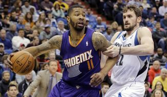 Phoenix Suns forward Markieff Morris (11) drives against Minnesota Timberwolves forward Kevin Love (42) during the second quarter of an NBA basketball game in Minneapolis, Sunday, March 23, 2014. (AP Photo/Ann Heisenfelt)