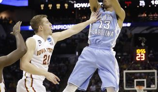 North Carolina's J.P. Tokoto (13) shoots over Iowa State's Matt Thomas (21) during the first half of a third-round game in the NCAA college basketball tournament Sunday, March 23, 2014, in San Antonio. (AP Photo/David J. Phillip)