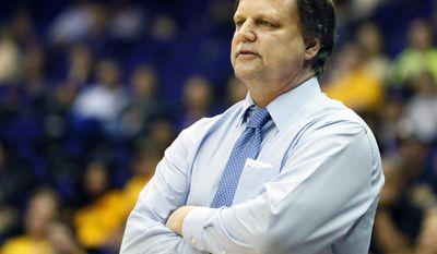 West Virginia basketball coach Mike Carey calls out to his team in the second half of an NCAA college basketball first-round tournament game against Albany, Sunday, March 23, 2014, in Baton Rouge, La. West Virginia won 76-61. (AP Photo/Rogelio V. Solis)