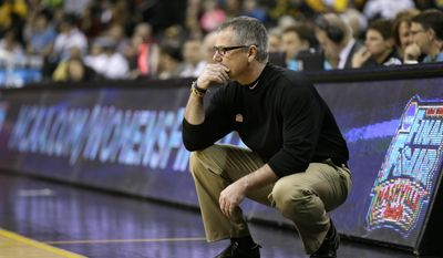 Idaho head coach Jon Newlee looks on during the first half of an NCAA tournament first-round women's college basketball game against Louisville, Sunday, March 23, 2014, in Iowa City, Iowa. (AP Photo/Charlie Neibergall)